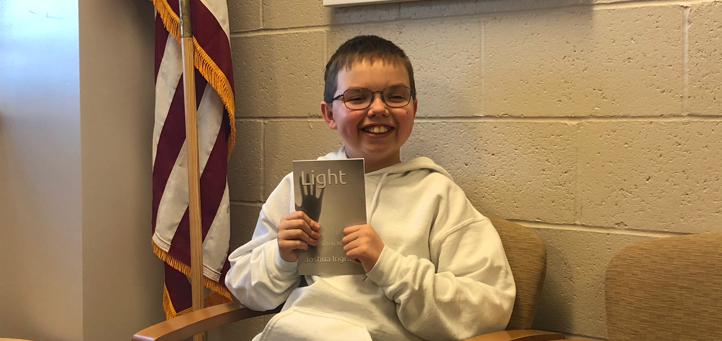 """Josh Ingram put his pen to paper and wrote his first book, """"Light – A Forgotten Monster,""""  this past December. The dynamic sixth-grade student, humble at heart and kind in spirit, has captured us all, enticing us to order our copy while the press is hot."""