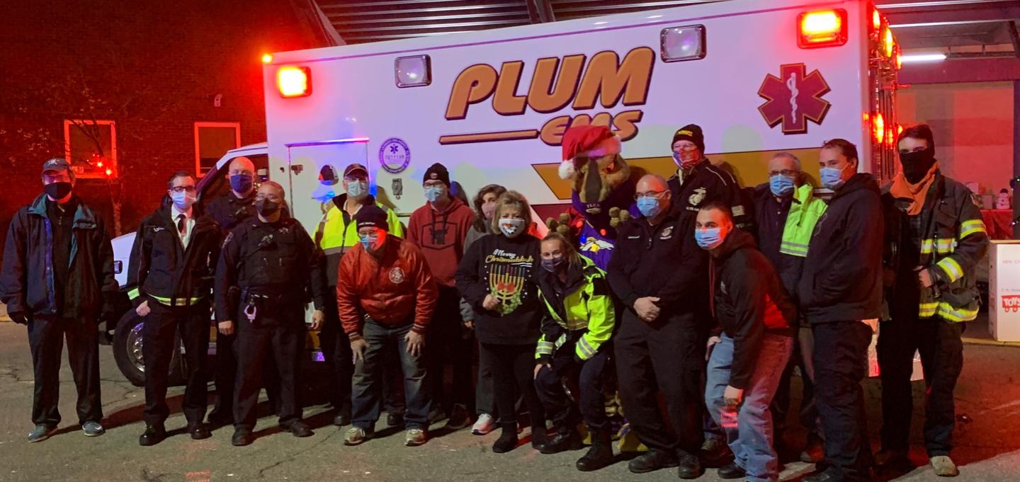 """Plum Borough School District has been a longtime supporter of the """"Toys for Tots"""" Stuff-A-Bus program, an initiative for underprivileged children in the community. This year, the District and Plum Emergency Medical Services (EMS) worked together to reach"""