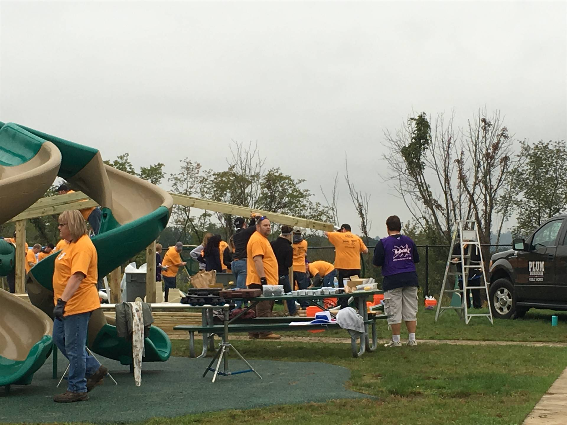 Volunteers working hard on the Rainbow Shade Structure
