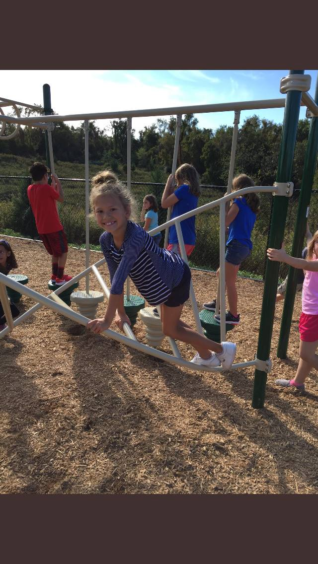 Students enjoying the new playground